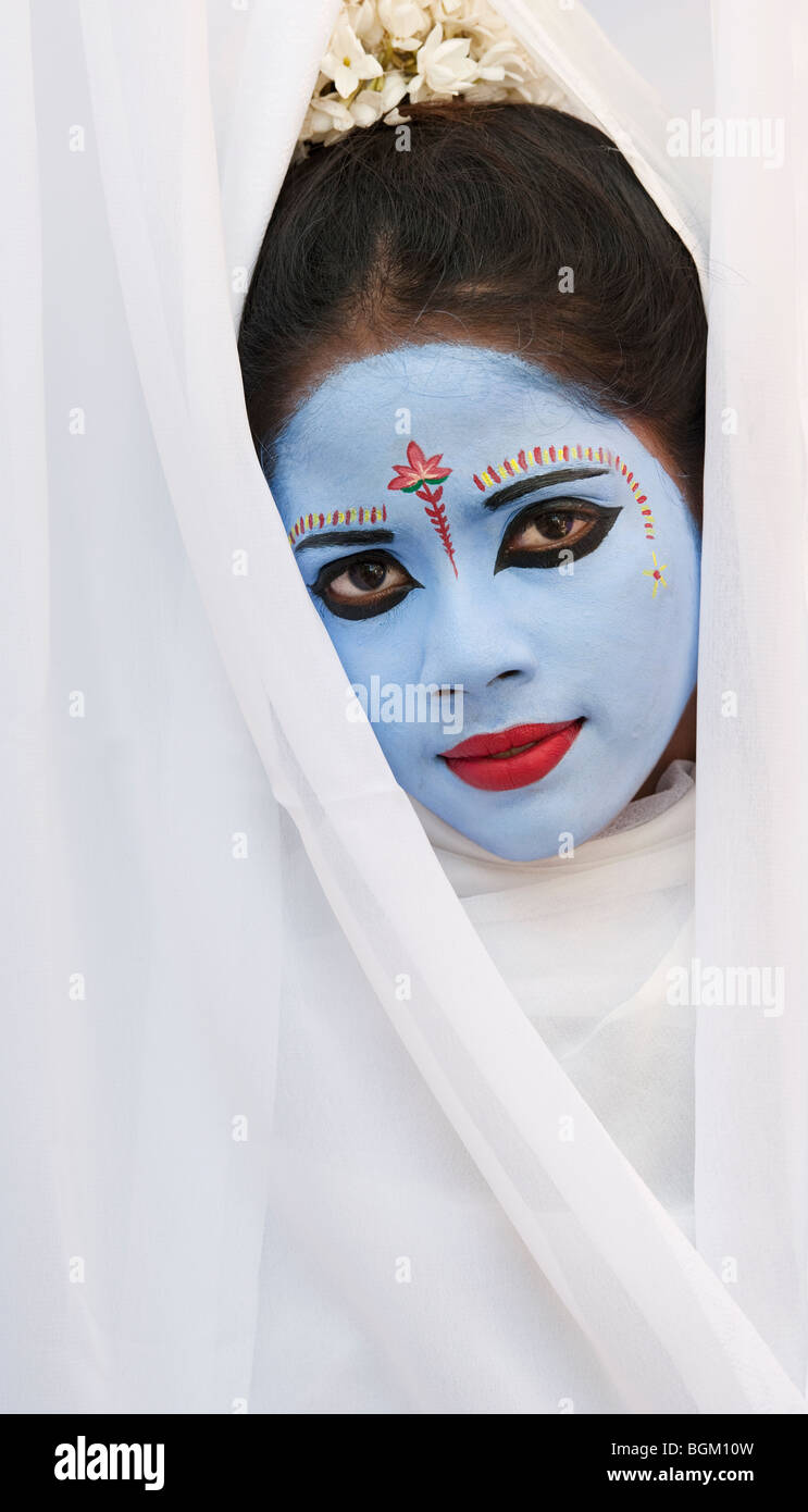 Indian girl, face painted as the Hindu goddess Sita. India - Stock Image