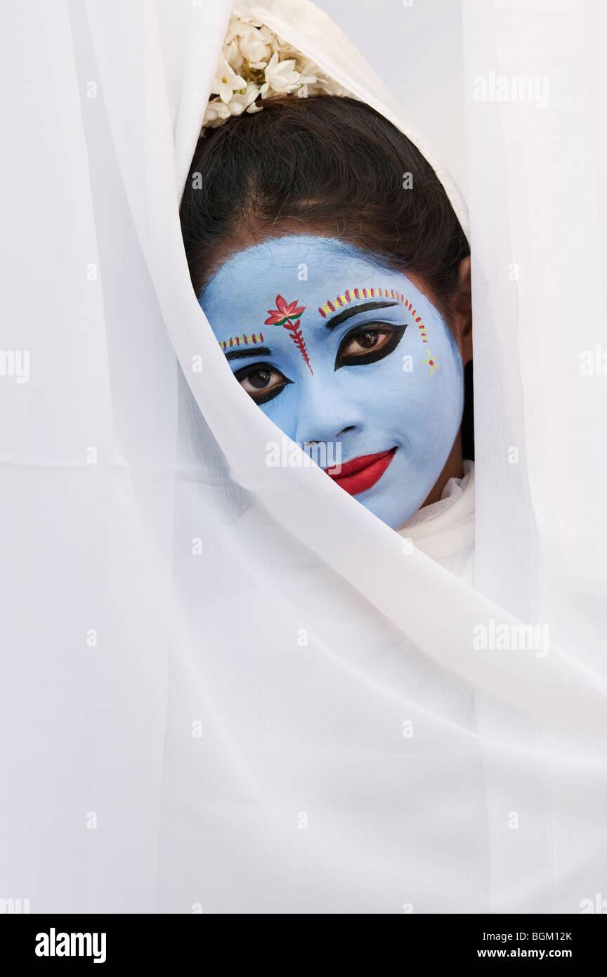 Indian girl, face painted as the Hindu goddess Sita. India - Stock Image