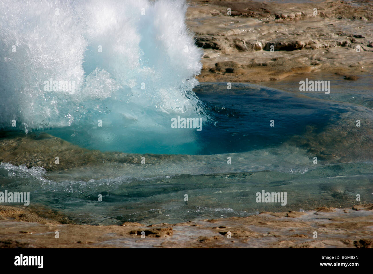 Eruption of the Strokkur / churn, fountain geyser in the geothermal area beside the Hvítá River in Iceland Stock Photo
