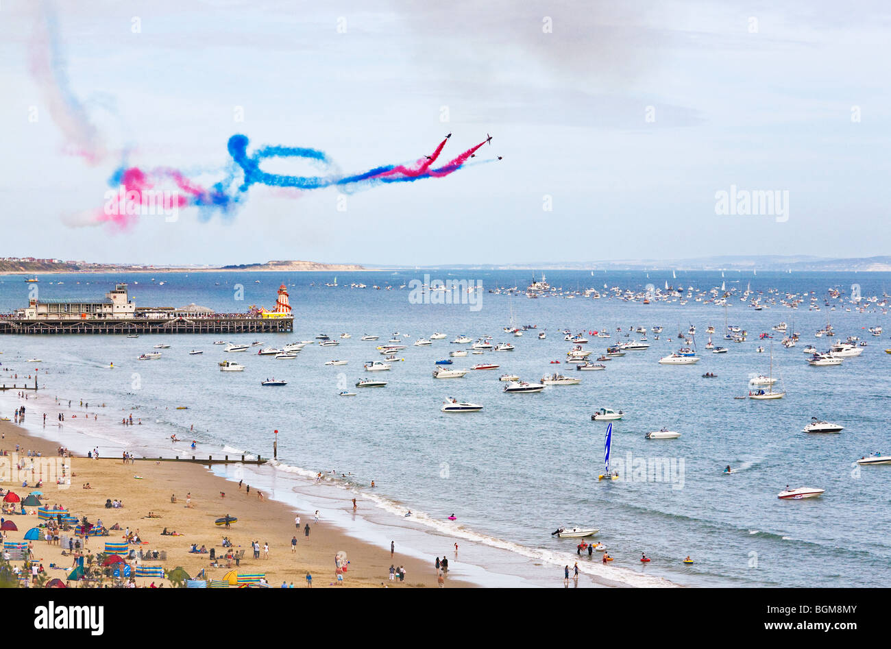 The Red Arrows display team performing their routine over the pier at the Bournemouth Air Festival. Dorset. UK. - Stock Image