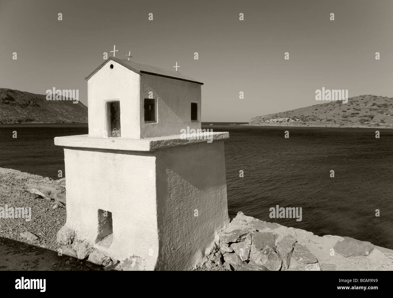 Little house statue along the road in  Mediterranean landscape overlooking the ocean,. Stock Photo