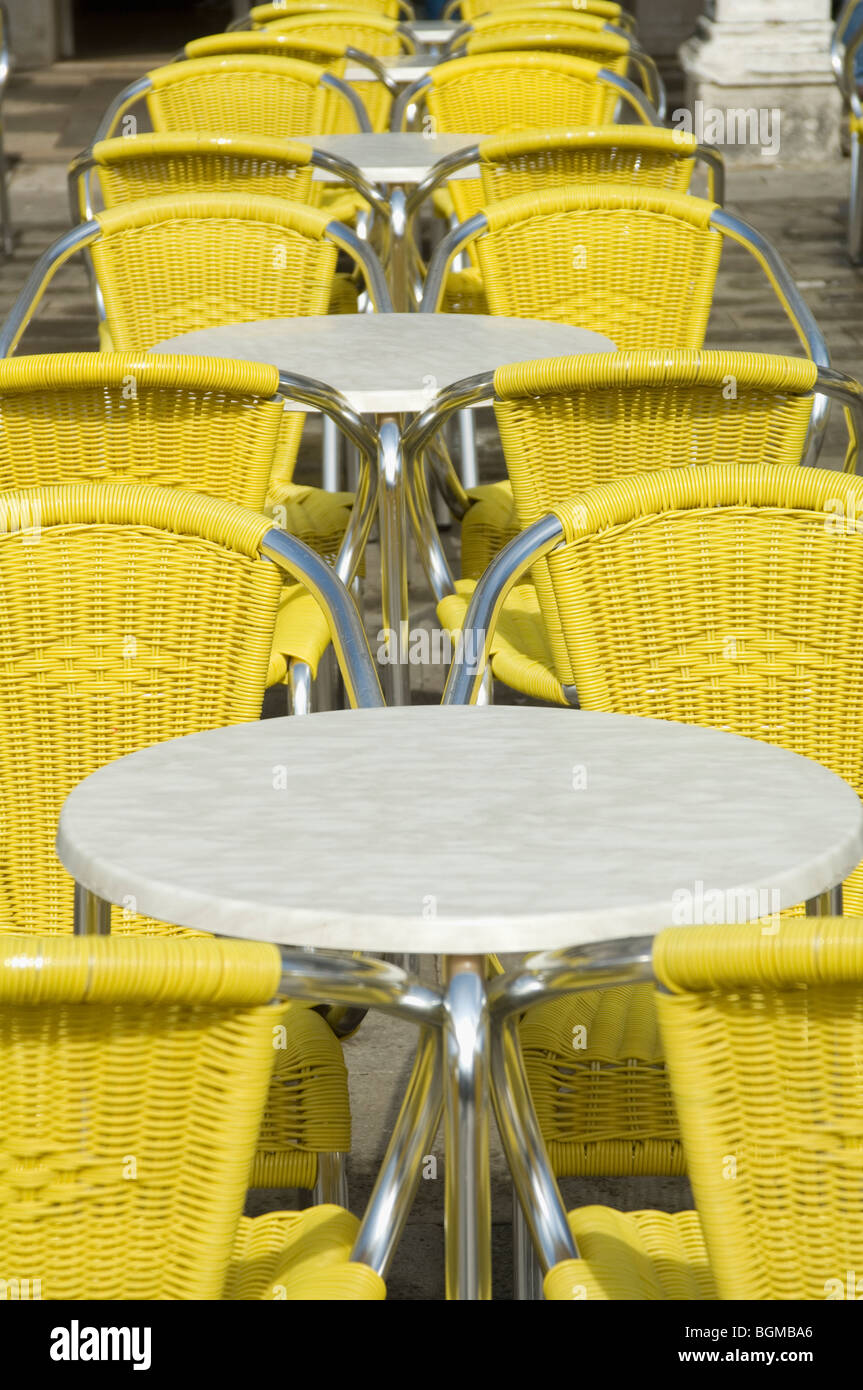 Astounding Bright Yellow Chairs And White Clothed Tables Of Outdoor Machost Co Dining Chair Design Ideas Machostcouk