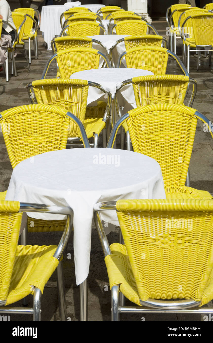 Incredible Bright Yellow Chairs And White Clothed Tables Of Outdoor Machost Co Dining Chair Design Ideas Machostcouk