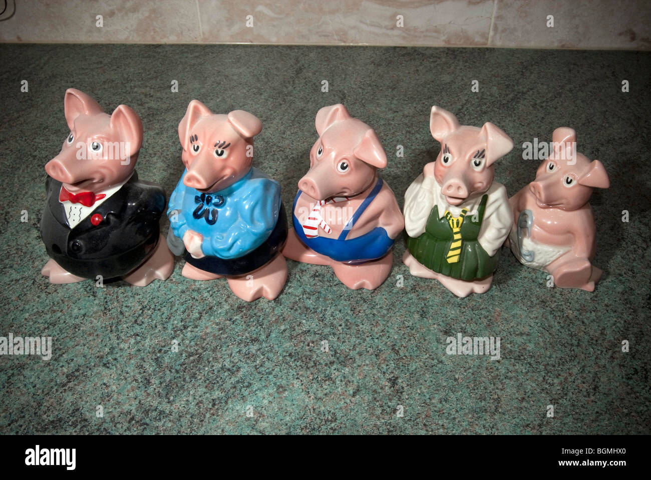 Wade porcelain Piggy bank family. Sir Nathaniel, Lady Hillary, Maxwell, Annabell and baby Woody. - Stock Image