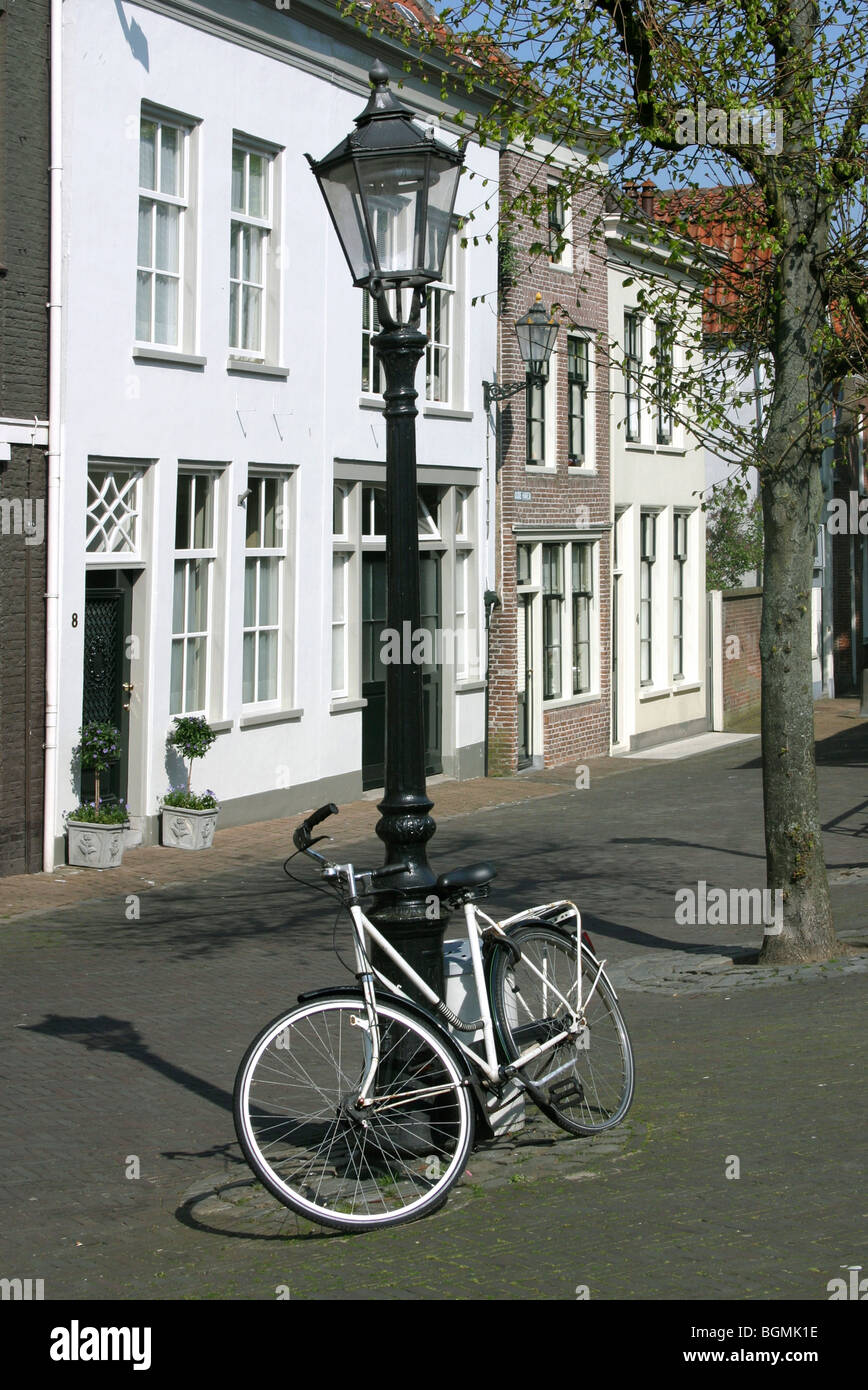 Dutch street with bicycle against streetlight, Schoonhoven, the Netherlands - Stock Image