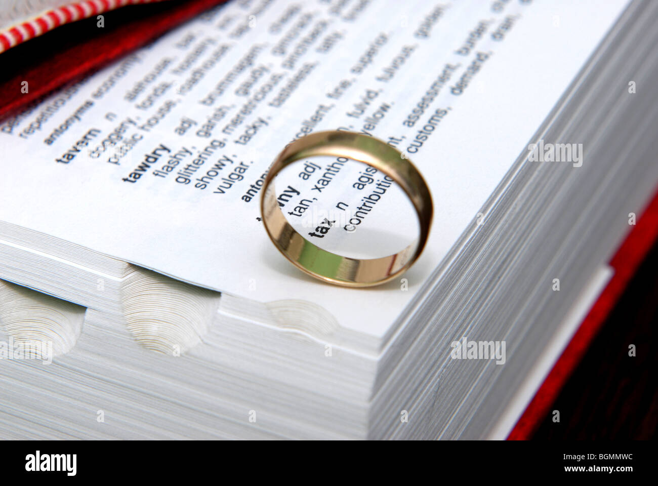 wedding ring on dictionary and thesaurus with the words Tax