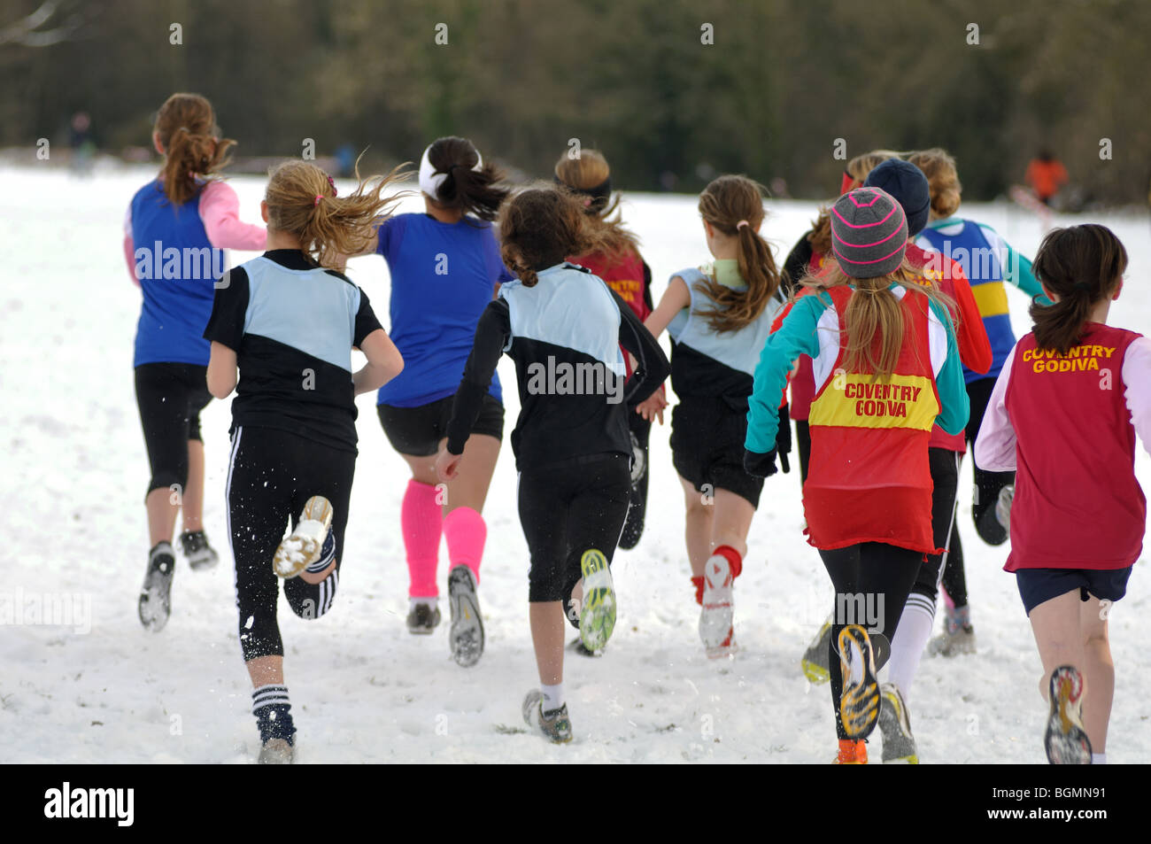 Teenage girls starting cross-country race in snow seen ...