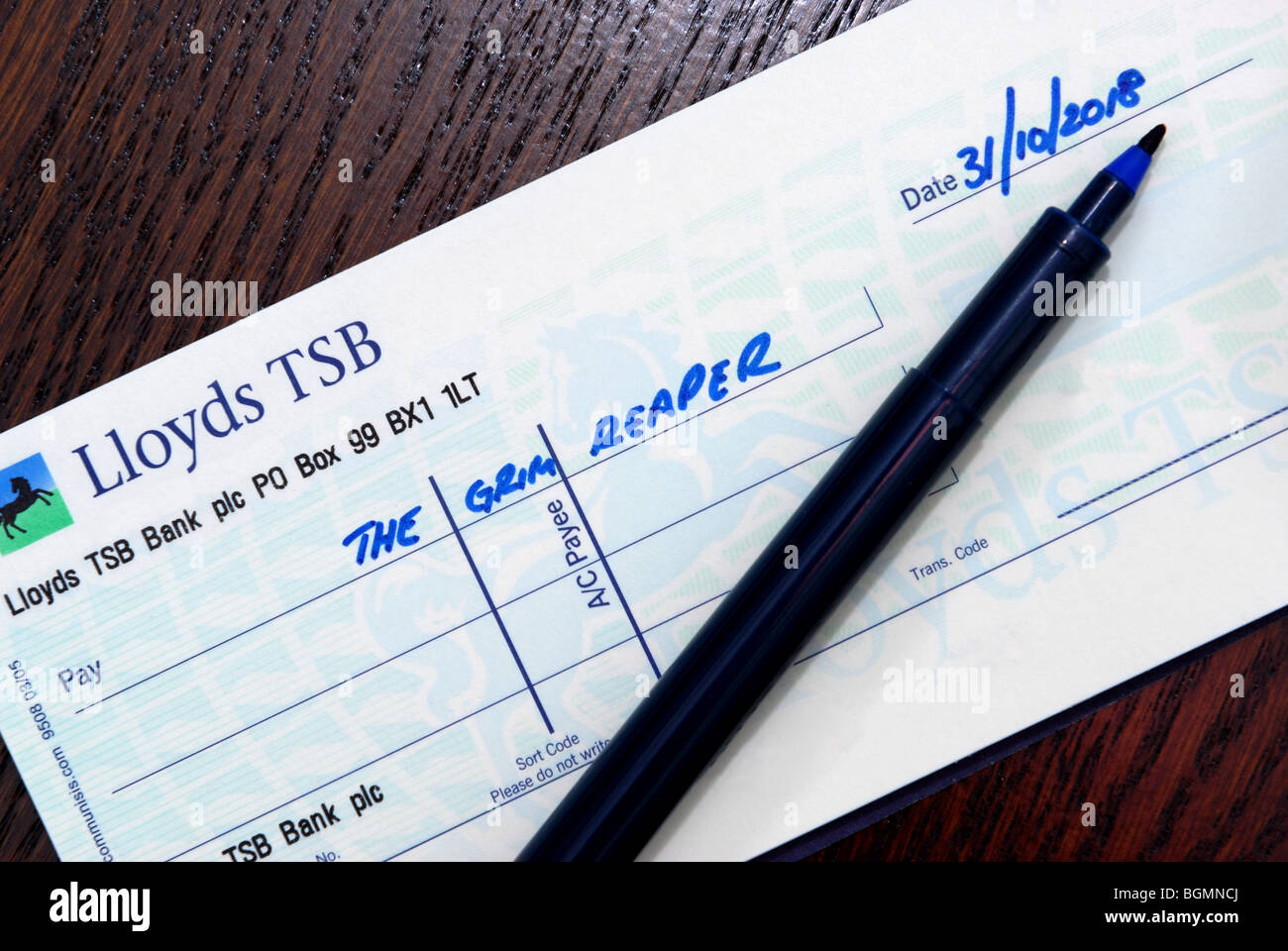 Cheque to the Grim Reaper dated 31 Oct 2018 to illustrate the potential last date for cheques as acceptable form - Stock Image