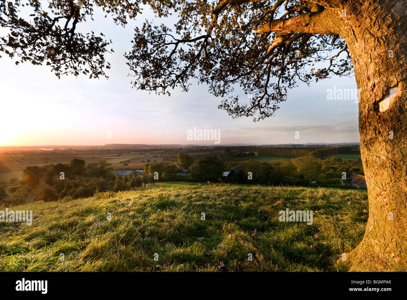 Sunrise at Burrow hill Somerset looking east over the levels. - Stock Image