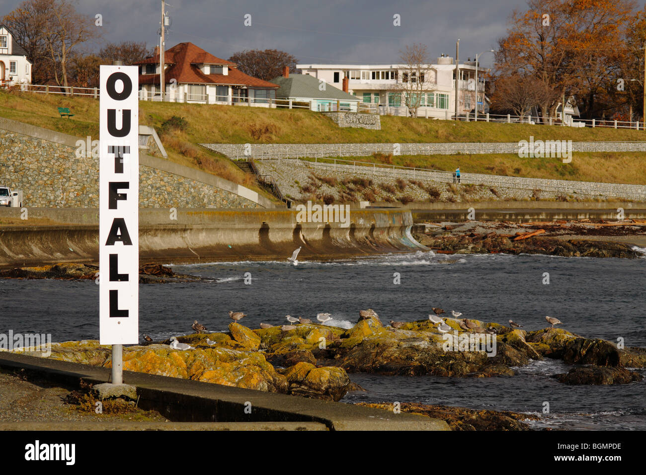 Sewage outfall sign at edge of Clover Point in Juan de Fuca Strait-Victoria, British Columbia, Canada. - Stock Image