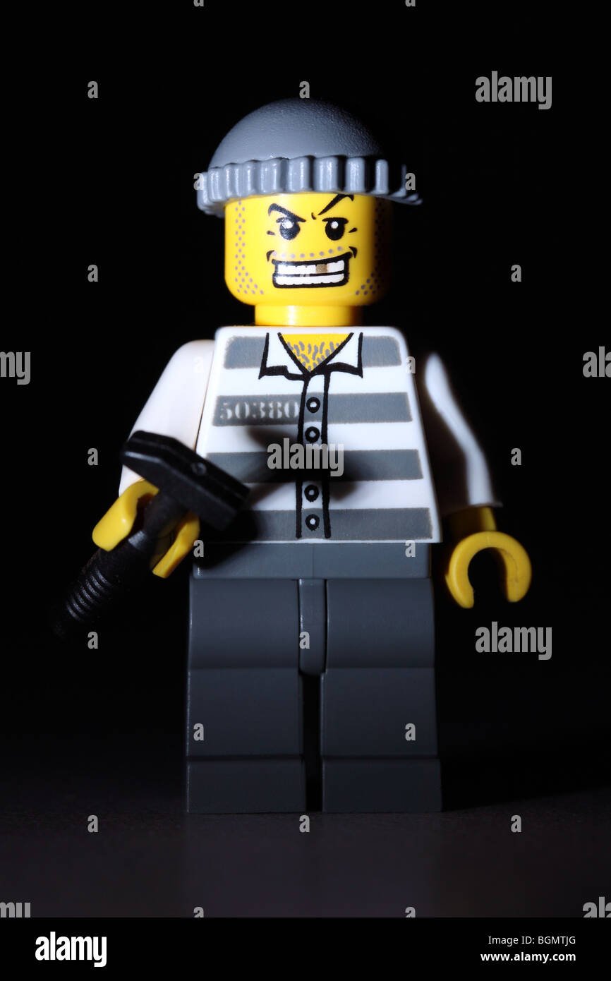Lego criminal about to commit a crime - Stock Image