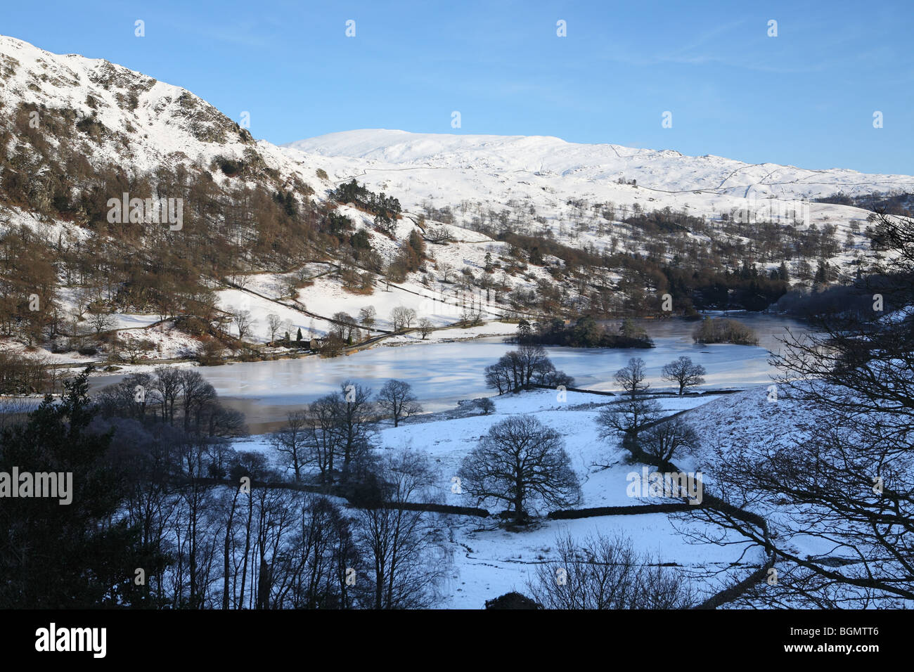 Rydal Water with snow clad mountains, Cumbria, UK - Stock Image