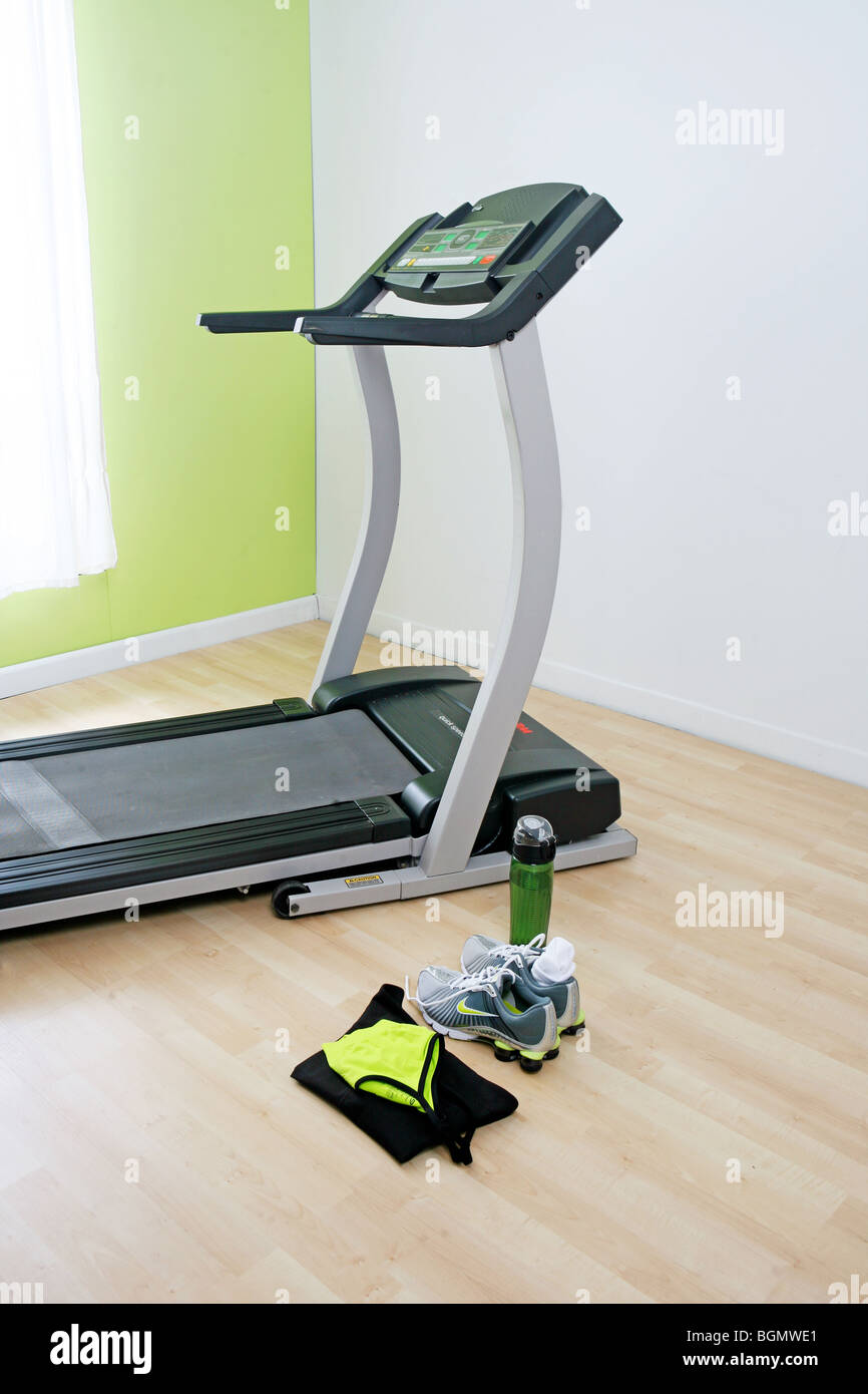 treadmill and work out clothes are ready to go - Stock Image