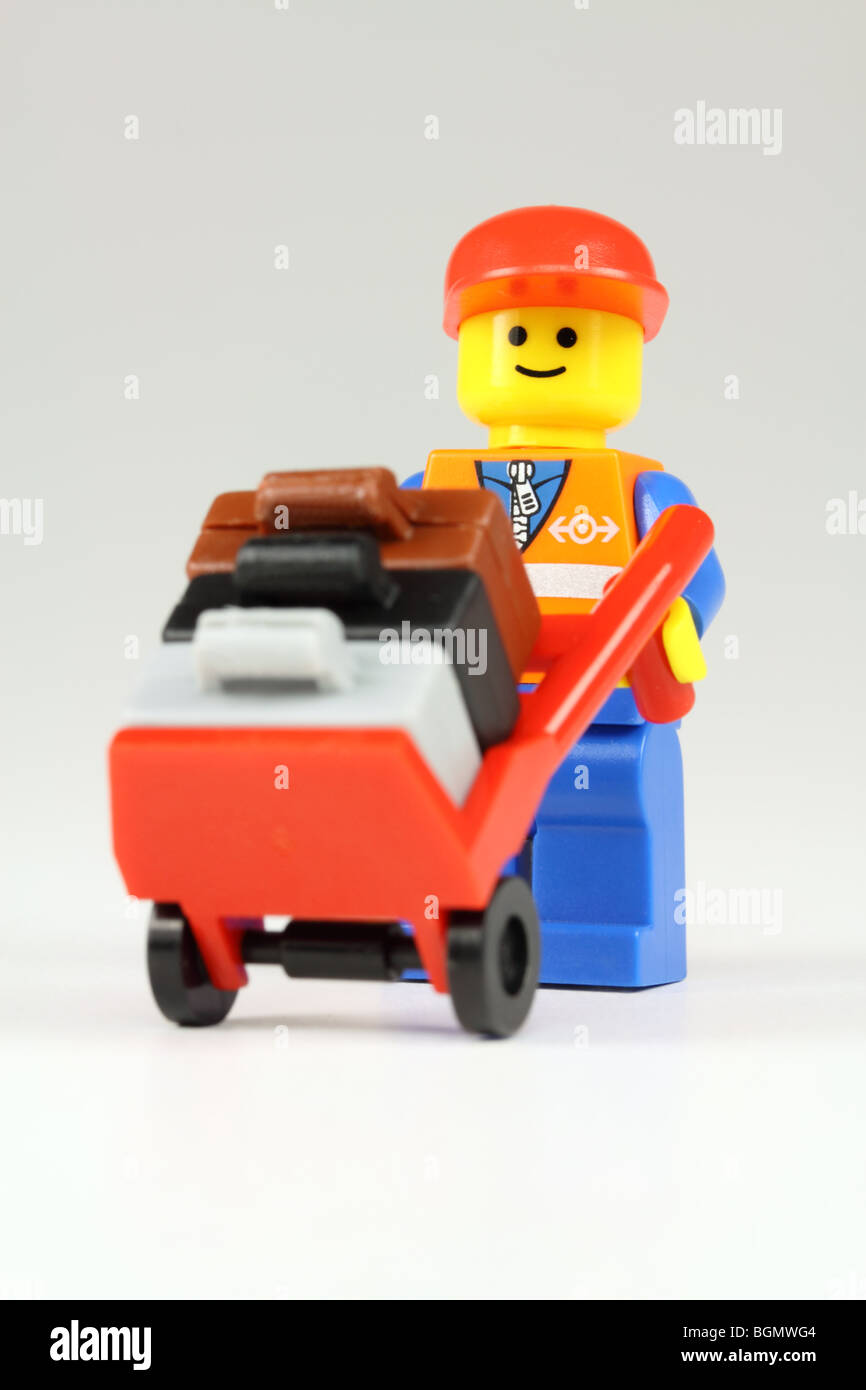 Lego airport baggage handler and suitcases - Stock Image