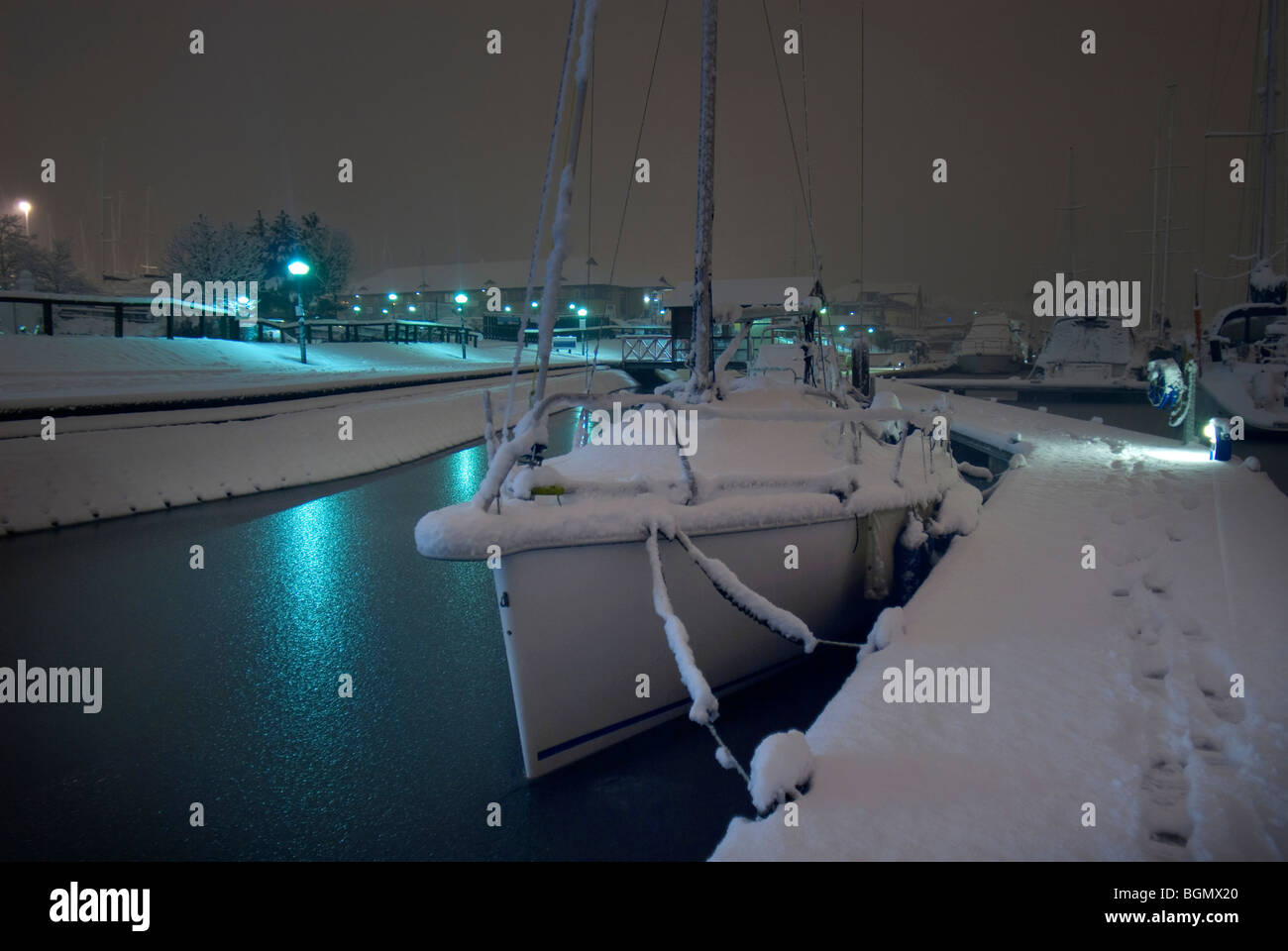 yacht covered in snow - Stock Image