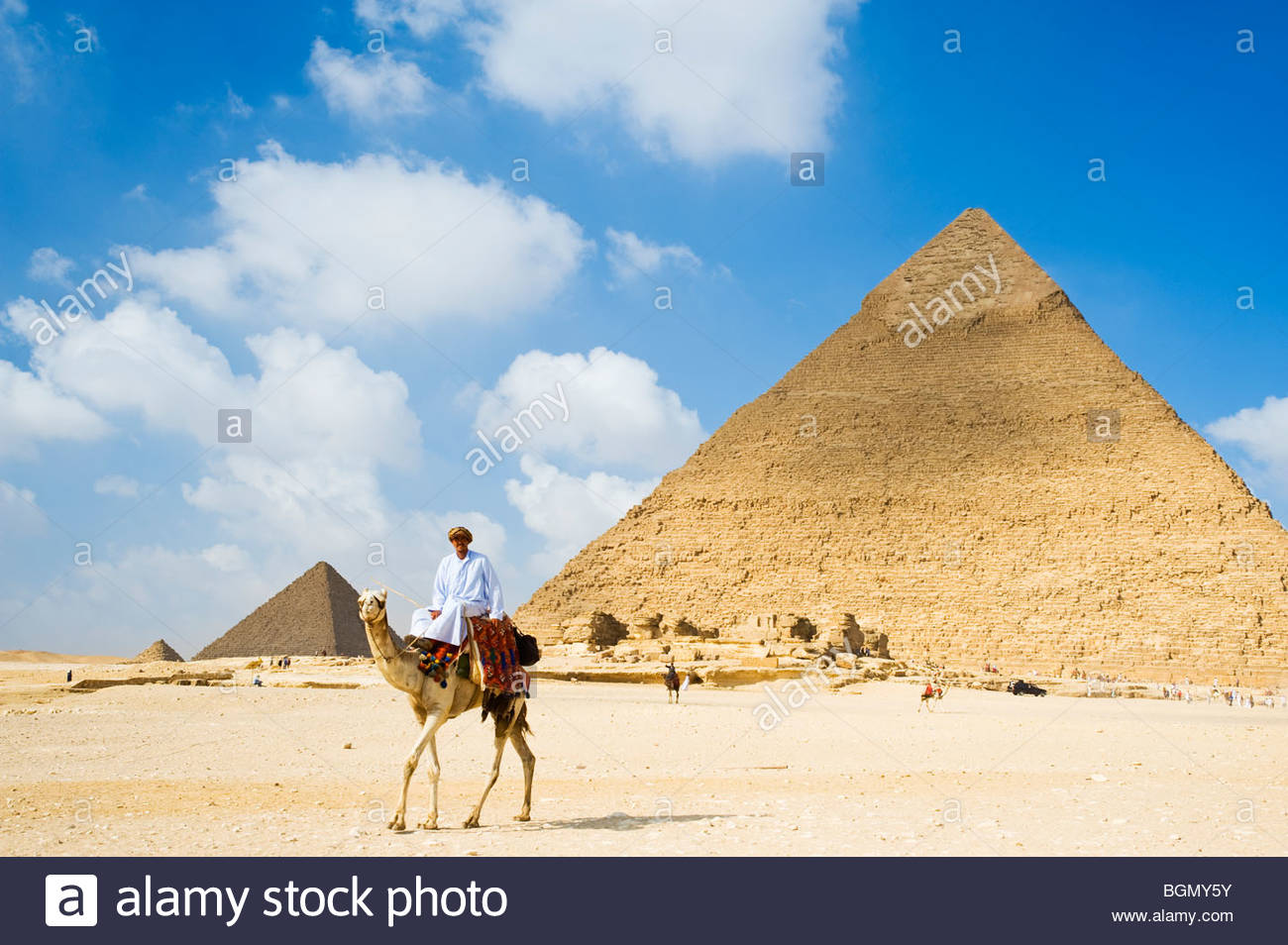 Guide on camel at the Great Pyramids of Giza, Cairo, Egypt. - Stock Image