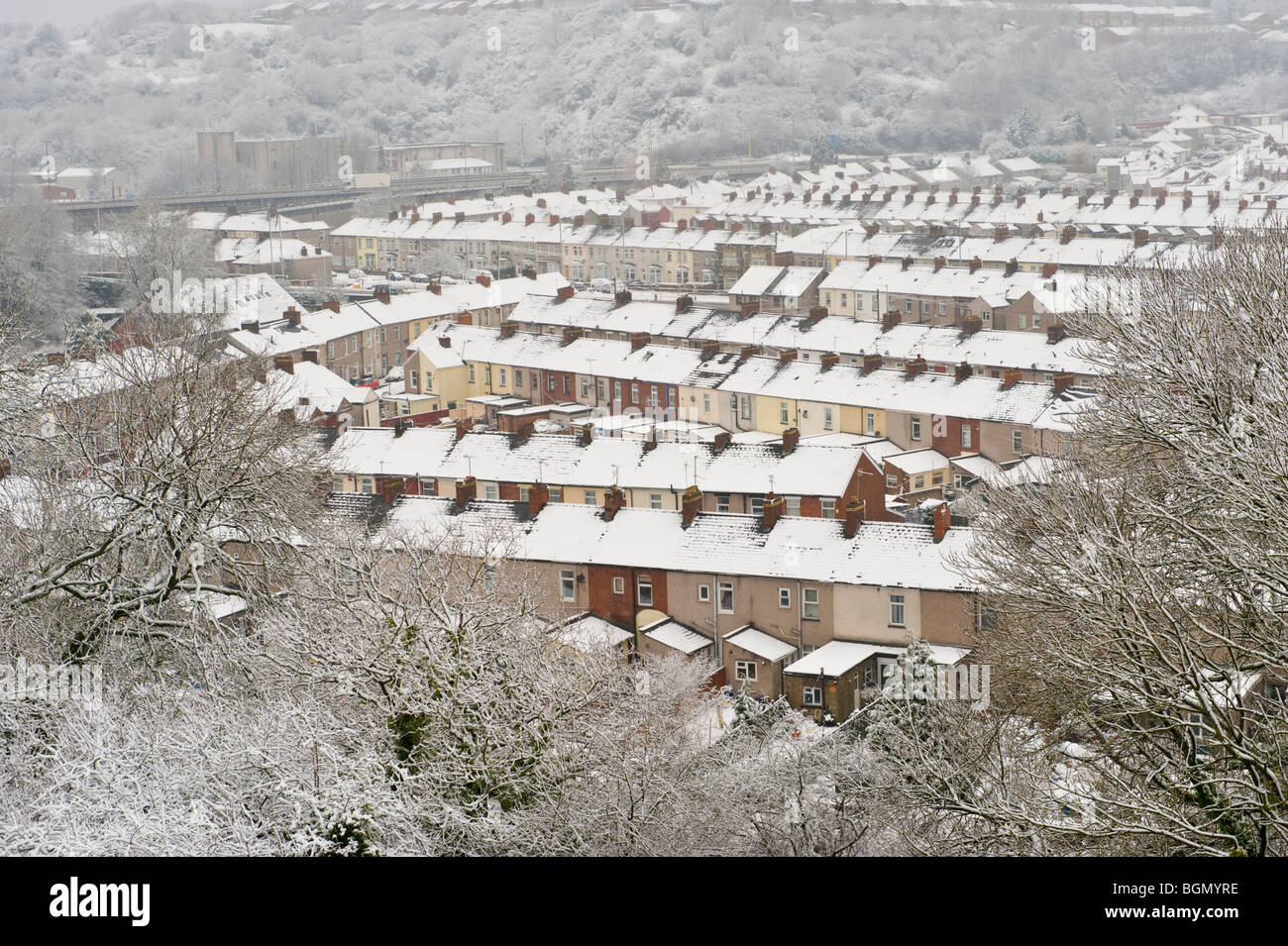 View over rooftops of terraced houses covered in snow at Newport South Wales UK - Stock Image