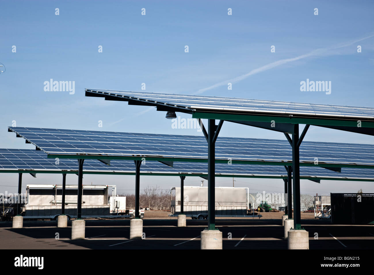 Solar panels, installed on roofs, agricultural vehicle parking. - Stock Image