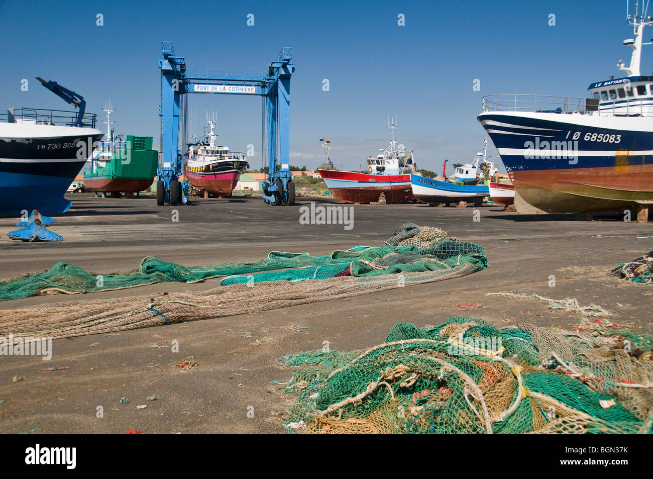 La Cotinière dry dock with trawlers, gantry crane, and fishing nets. (Oléron Island, France) - Stock Image