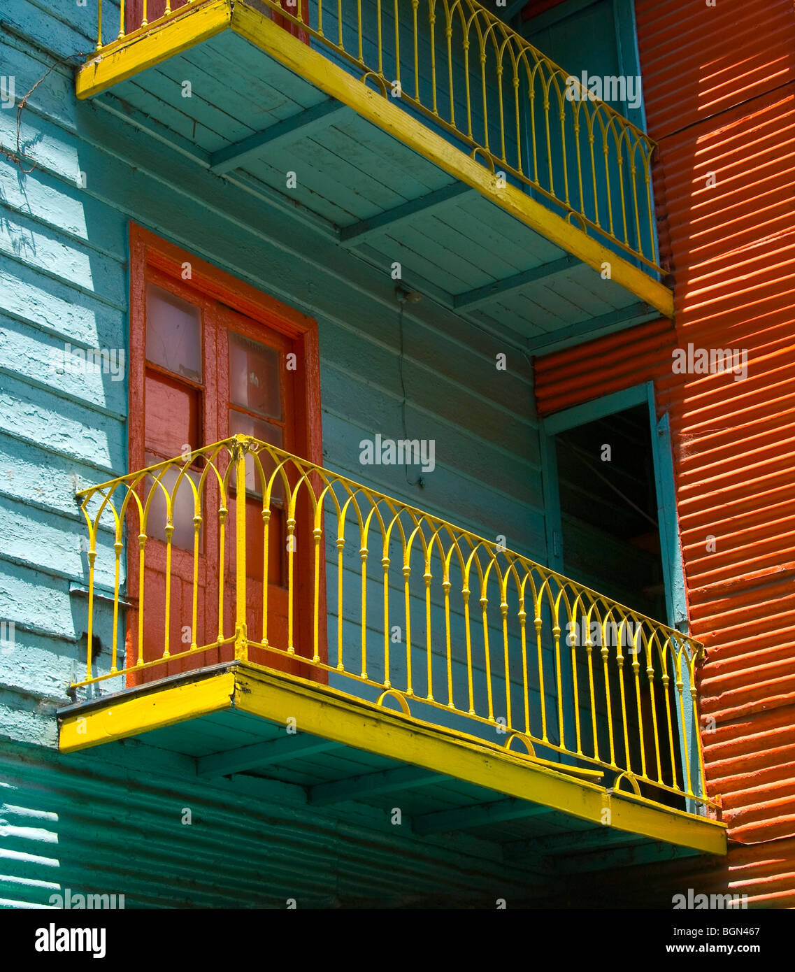Colorful buildings lining the pedestrian street, La Caminto, in the neighborhood of La Boca, Buenos Aires, Argentina - Stock Image
