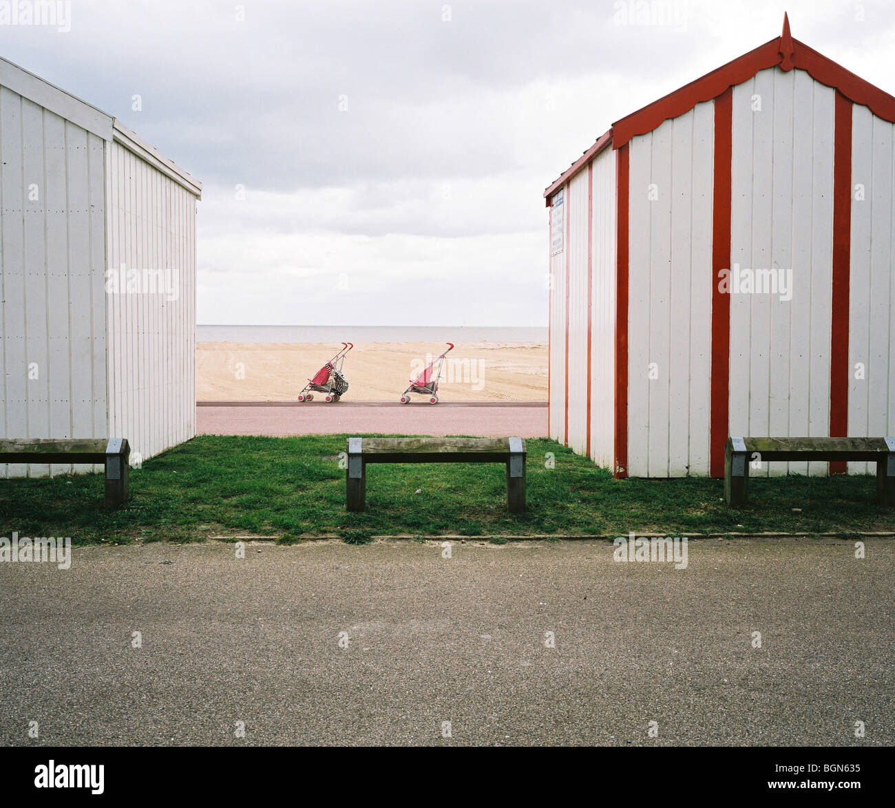 Beach huts and buggies on the Norfolk coast at Great Yarmouth - Stock Image