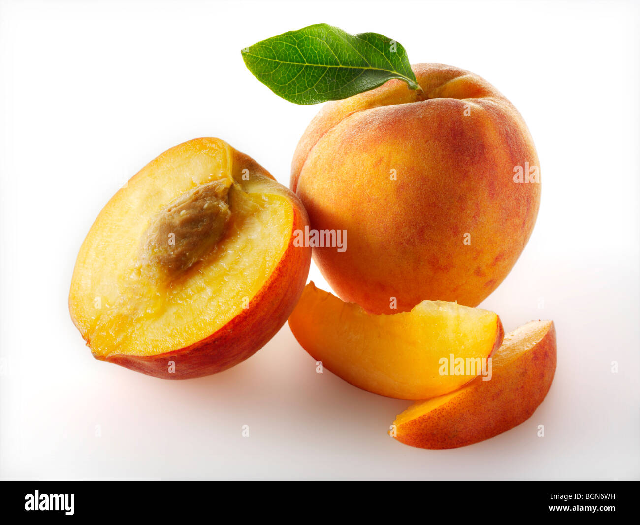 Fresh apricots whole and cut in halves - Stock Image