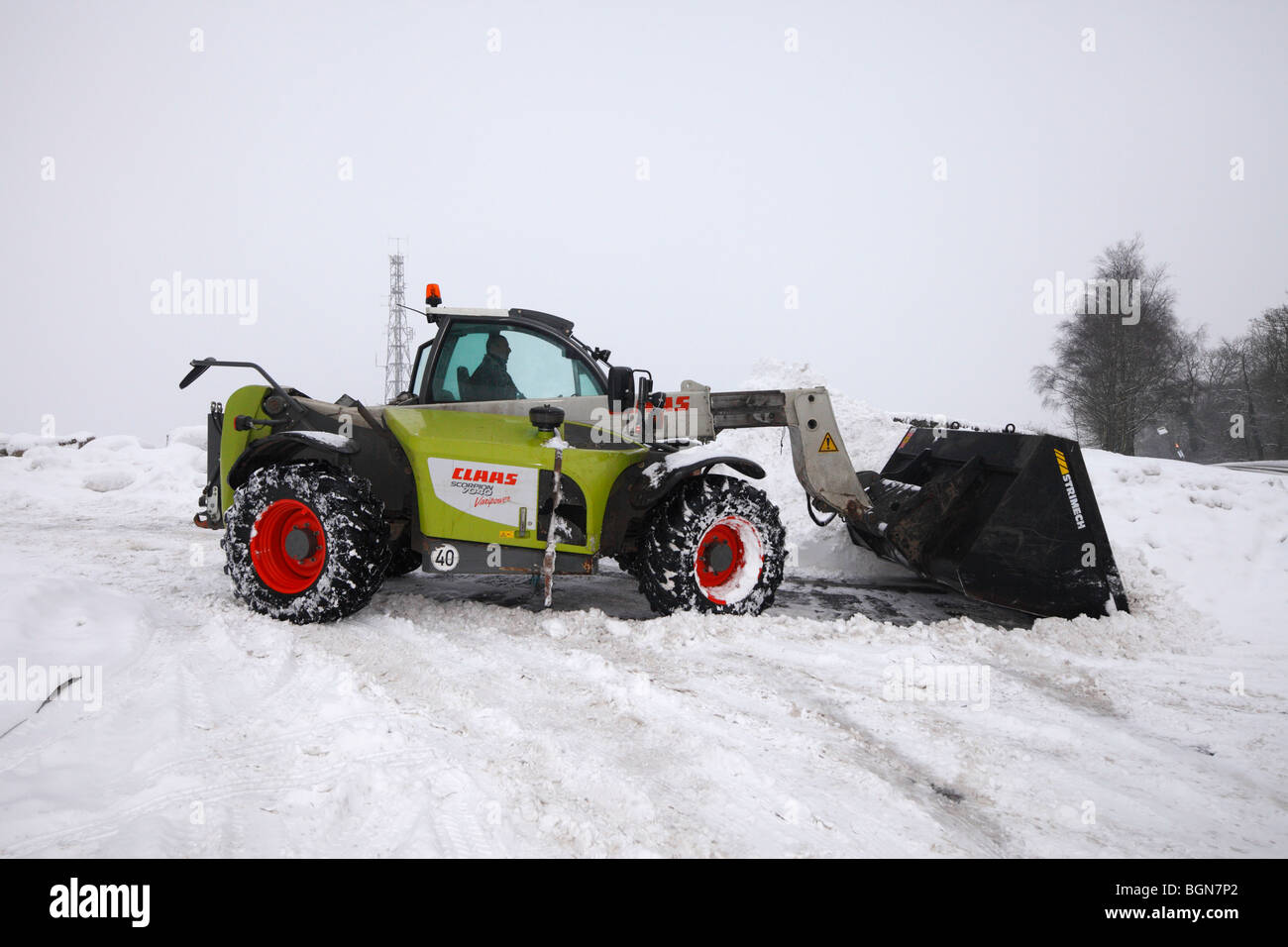 Claas Scorpion 7040 machine clearing snow. - Stock Image