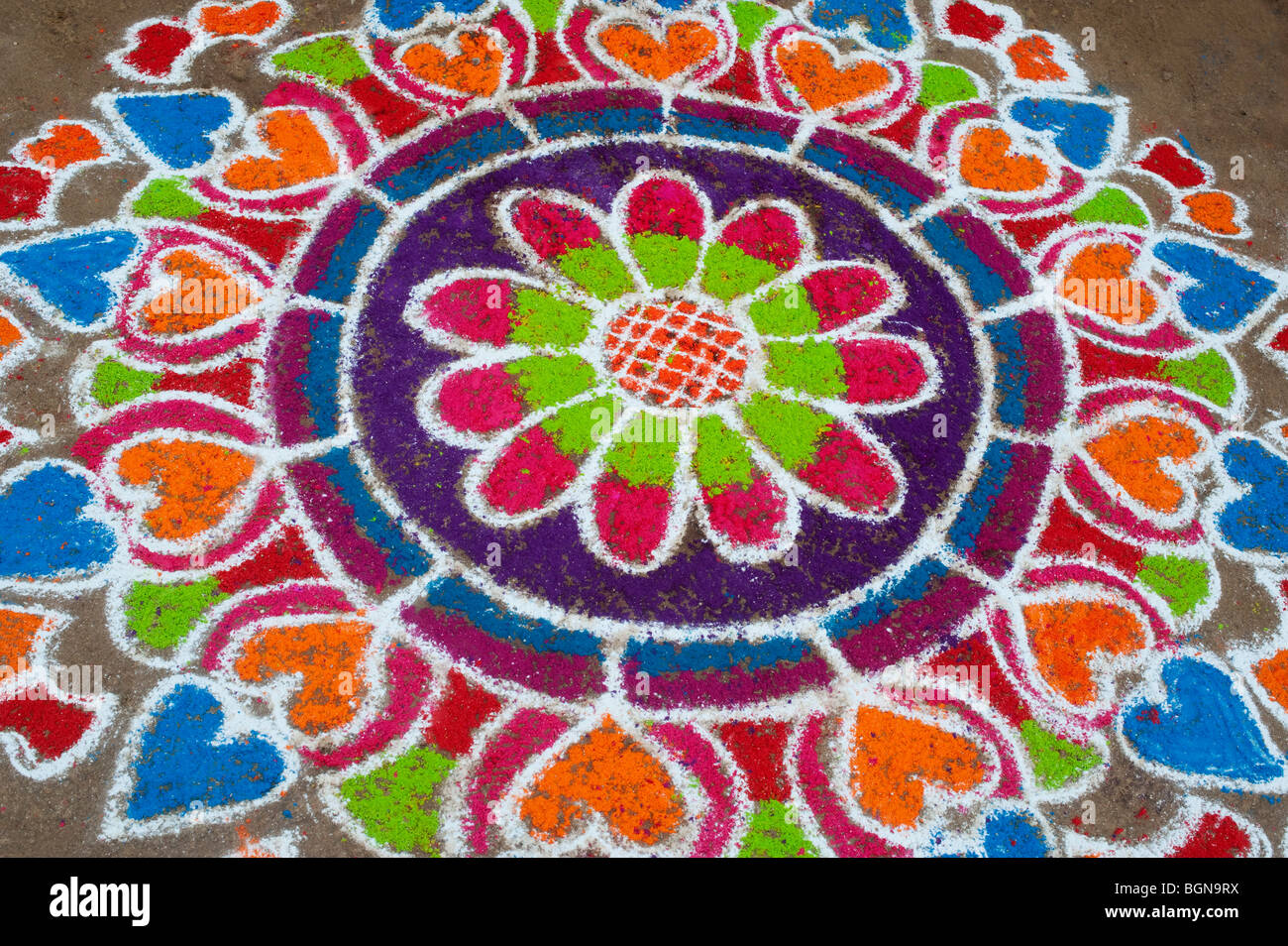 Rangoli designs in an Indian street , during the hindu festival of Sankranthi. Puttaparthi, Andhra Pradesh, India Stock Photo