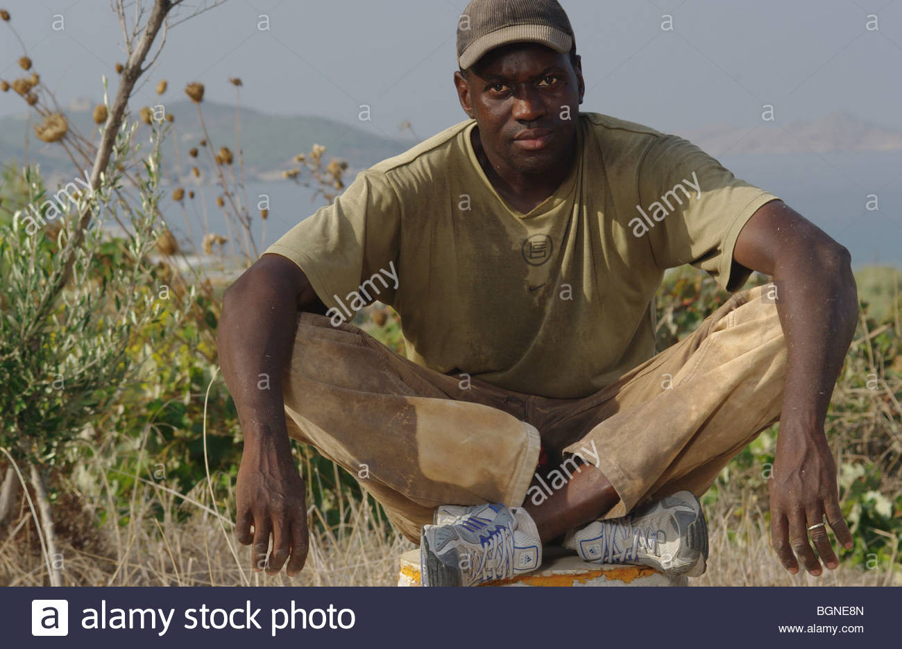 Izza, a 31 year old migrant worker from Senegal, Africa poses in Greece - asylum seekers - Stock Image
