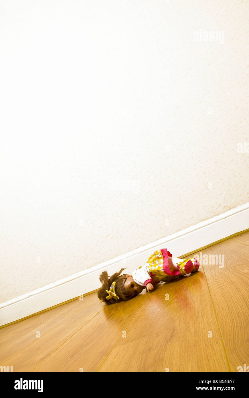 Doll laying on floor - Stock Image