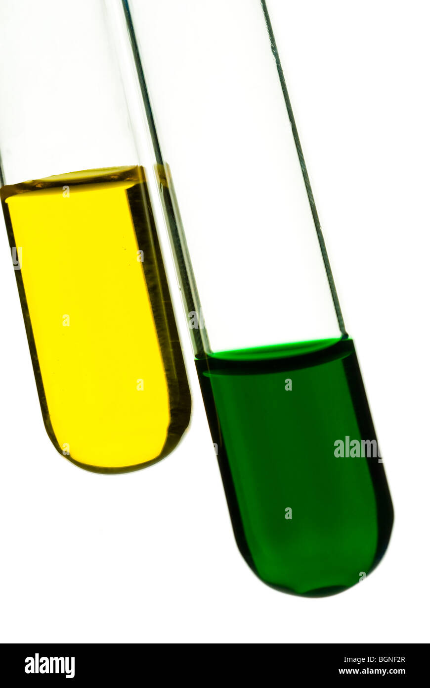 close-up of test-tubes with green and yellow samples - Stock Image
