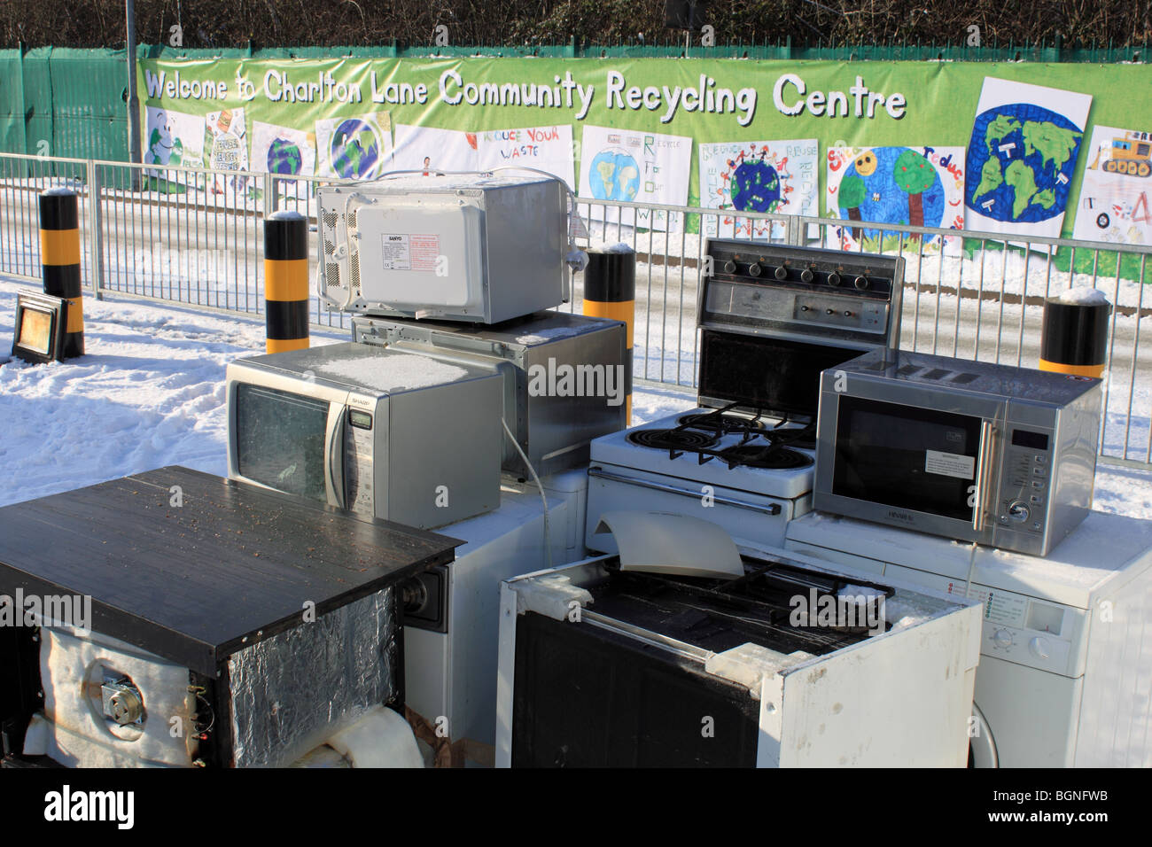 Old cookers and microwaves at Charlton Lane Community Recycling Centre, Shepperton, Surrey, England, Great Britain, - Stock Image