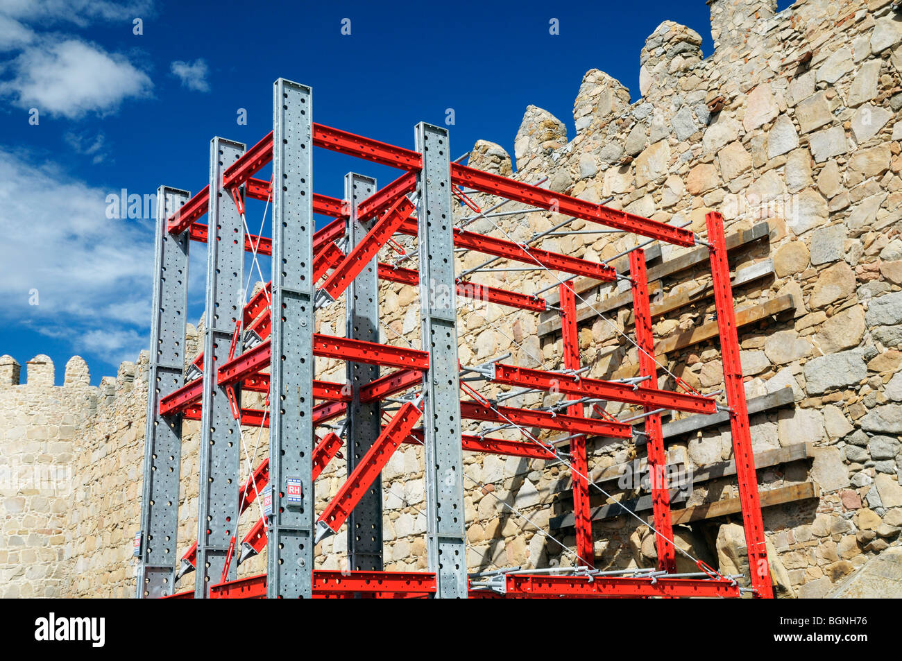 Specialized scaffolding for structural reinforcement, City walls of Avila, Spain Stock Photo