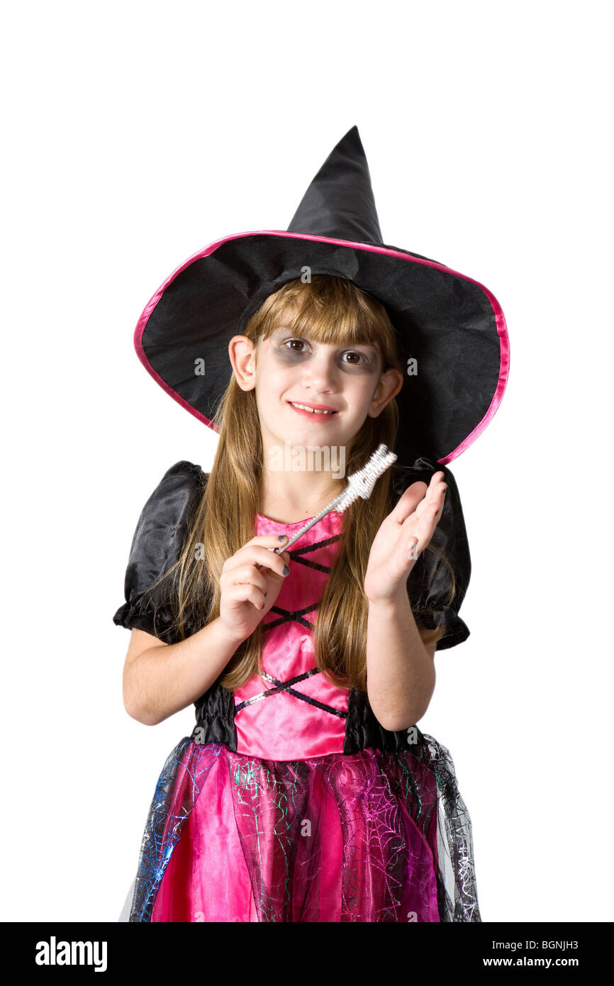 4320439cac5d little cute girl in carnival fancy dress with magic wand on the eve of  Halloween