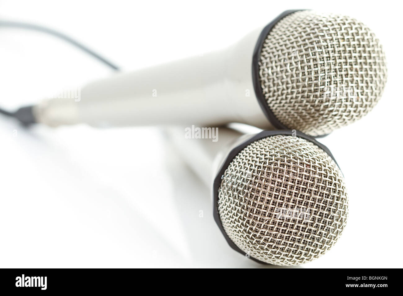 Two microphones on reflecting white background - Stock Image
