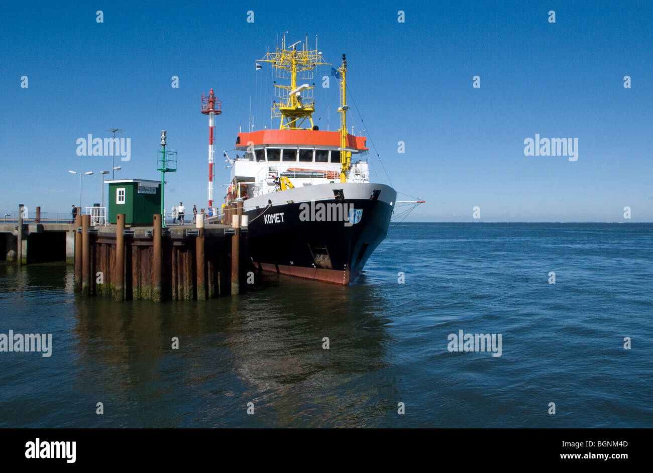 cargo ship at a pier on the island of sylt in northern germany - Stock Image