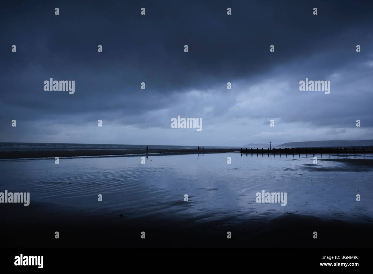 January twilight, beach,overcast, cloudy, grey, evening, stormy, brooding sky, Borth, ceredigion wales UK - Stock Image