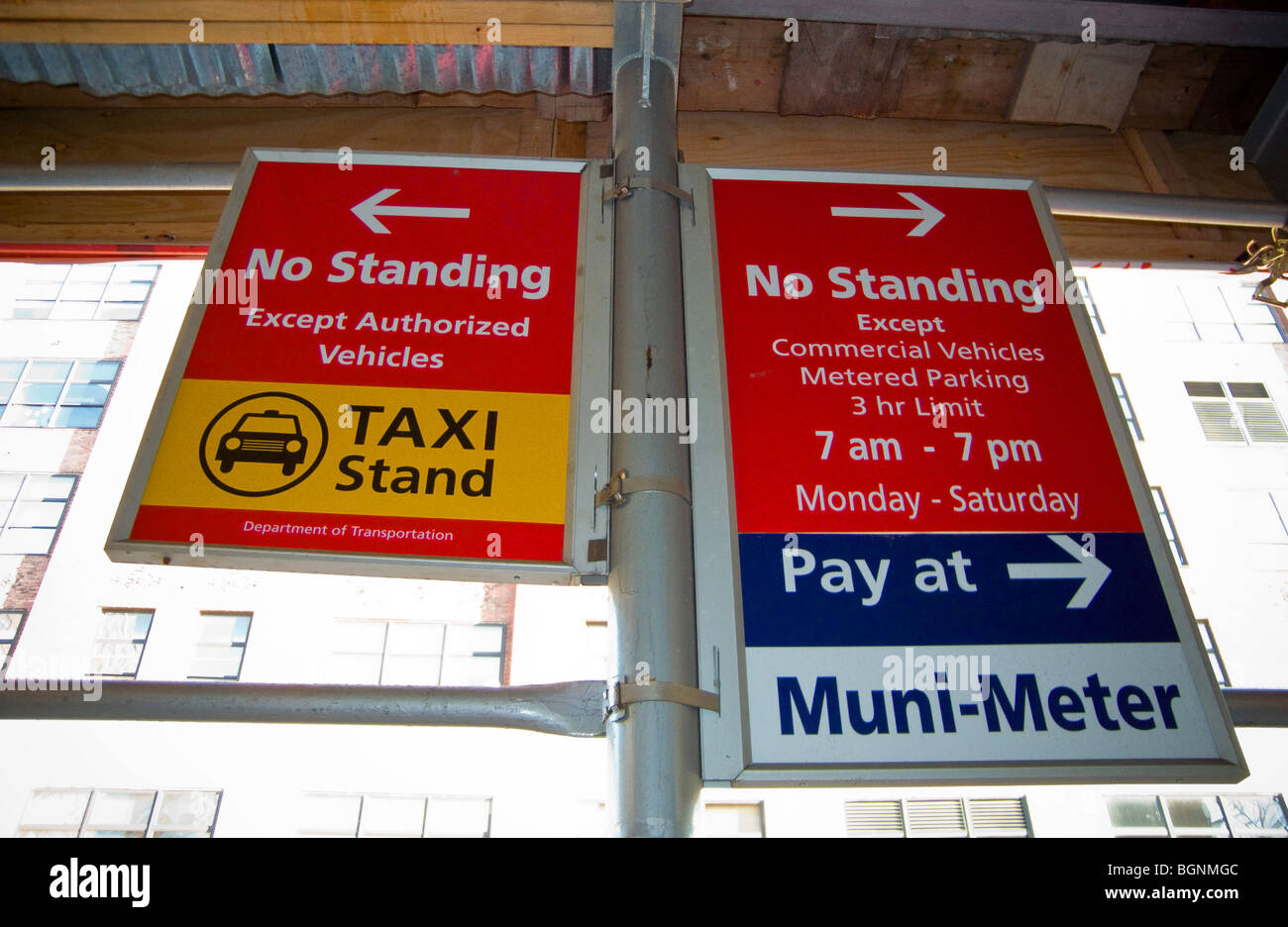A set of No Standing signs designating a taxi stand and munimeter parking is seen in New York - Stock Image