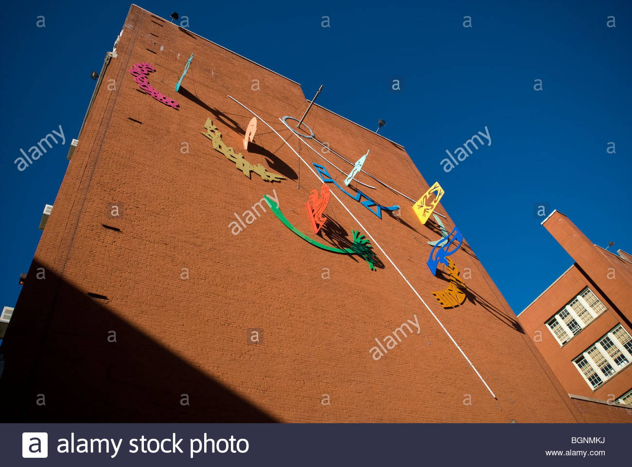 The Helio–Chronometer Sculpture is seen on the exterior wall of a public school in the New York neighborhood of - Stock Image