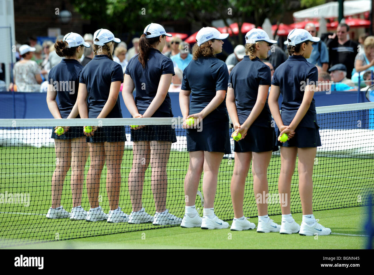 Ball girls line up on court before a match at the Aegon International 2009 Tennis Championships at Devonshire Park - Stock Image