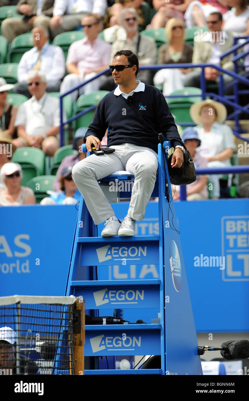 Male tennis umpire watches a match during the Aegon International 2009 Tennis Championships at Devonshire Park Eastbourne - Stock Image