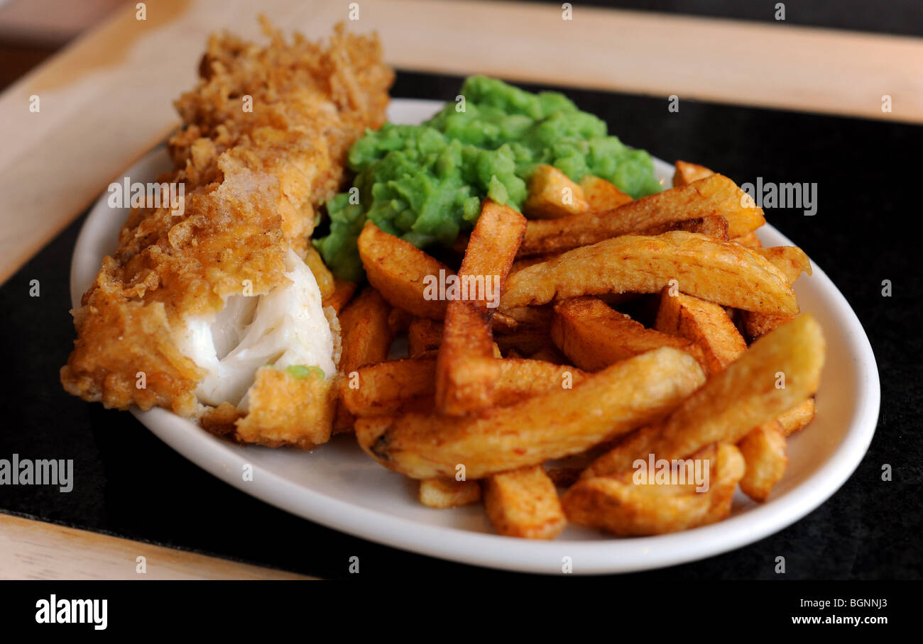 A  plate of fish chips and mushy peas Stock Photo