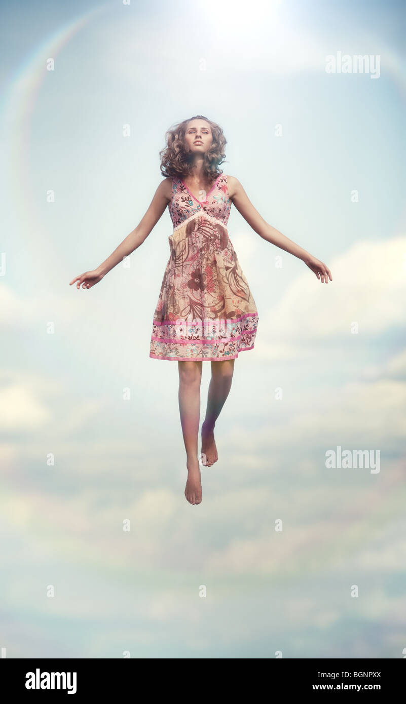 Young woman flying up. Soft colors. - Stock Image