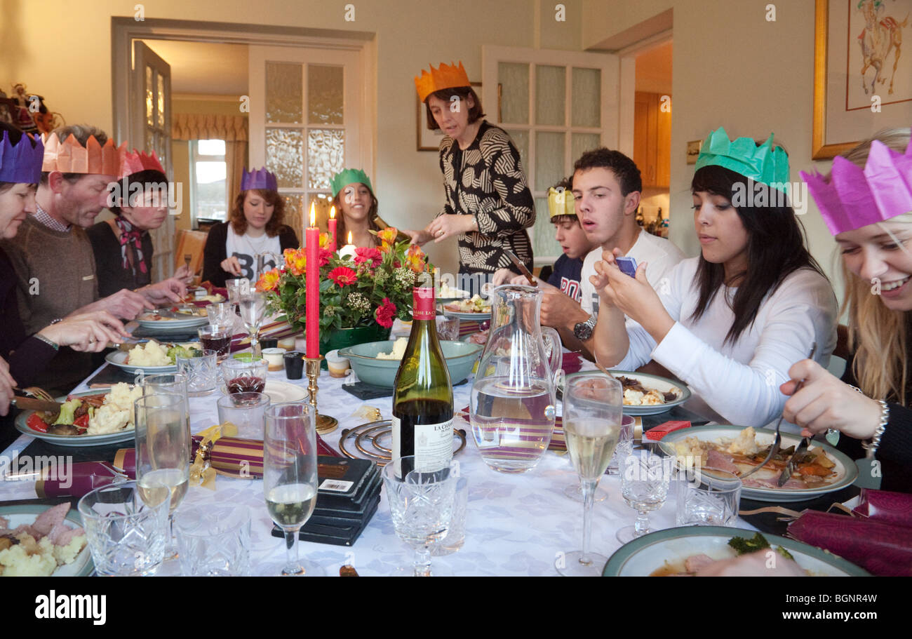 family and friends at a christmas dinner party on xmas day in the uk - Christmas Dinner Party