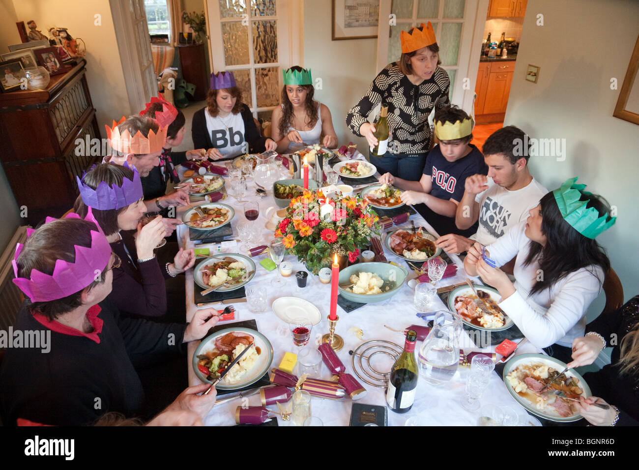 family and friends at a christmas dinner party on xmas day in the uk stock - Christmas Dinner Party