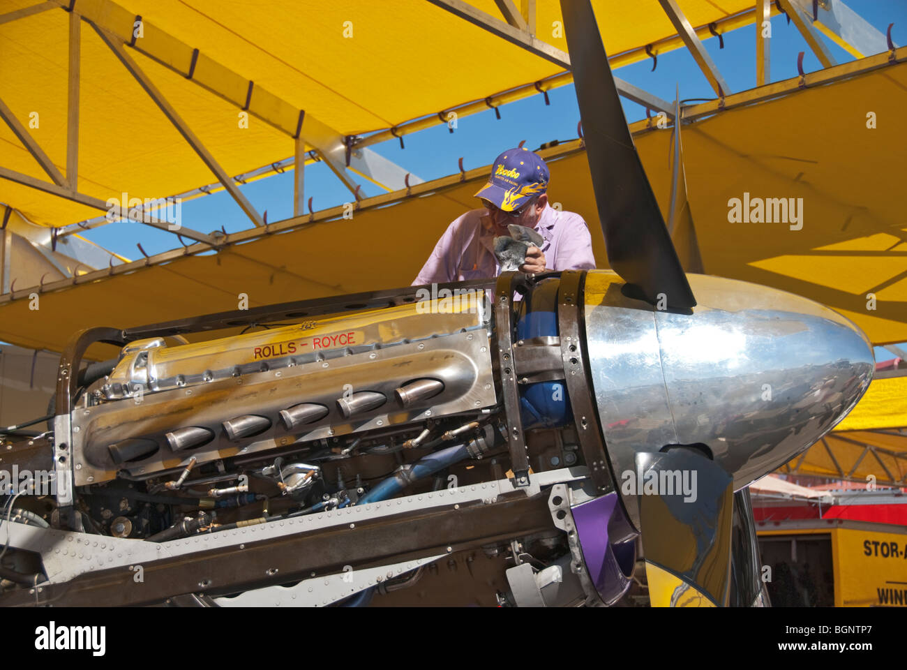 Nevada Reno Air Races P-51 Mustang race airplane mechanic in pits working on 12 cylinder Rolls - Royce engine - Stock Image