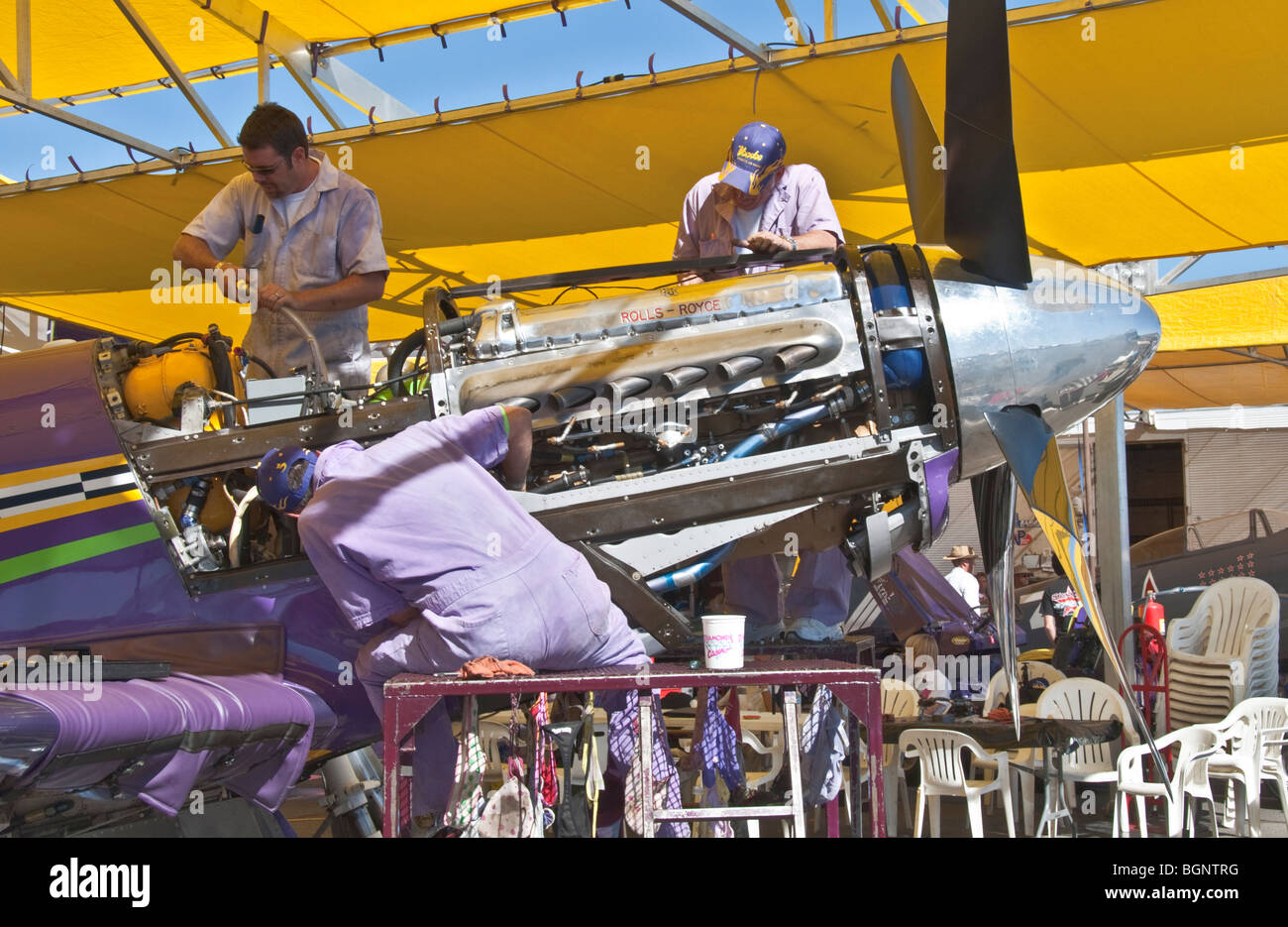 Nevada Reno Air Races P-51 Mustang race airplane mechanics in pits working on 12 cylinder Rolls - Royce engine - Stock Image