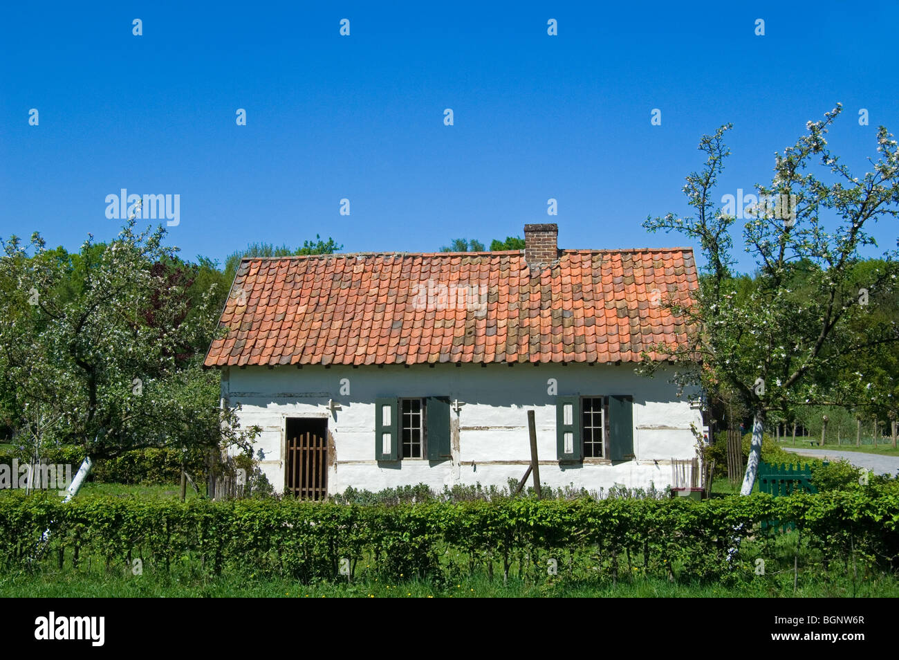 Old white house of agricultural labourer at the open air museum Bokrijk, Belgium - Stock Image