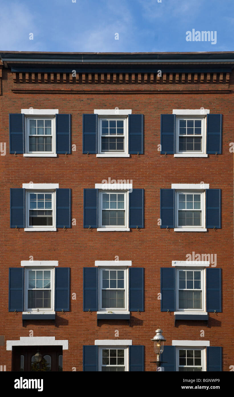 Blue shutters on a colonial style BRICK BUILDING - BOSTON, MASSACHUSETTS - Stock Image