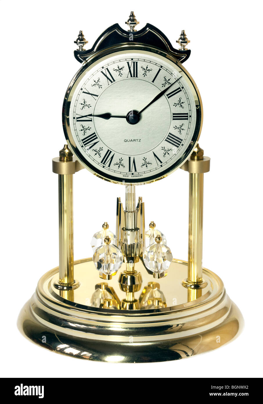 Ornate Rotating Pendulum Clock - Stock Image
